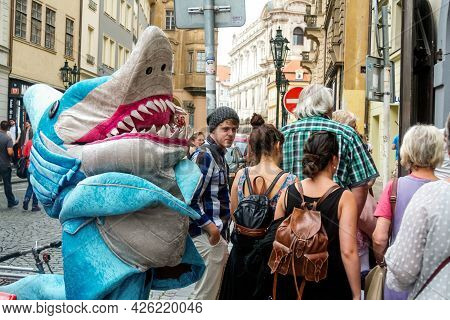 Prague, Czechia - July 2, 2014: Man, Worker, Disguised With A Giant Shark Costume Advertising For Sh