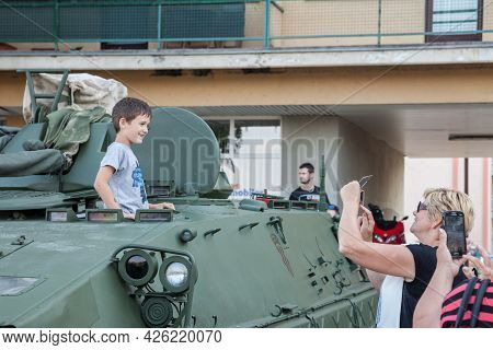 Vukovar, Croatia - May 11, 2018: Kid, Boy, Young, Being Talekn In Photo By His Parents In An Armored
