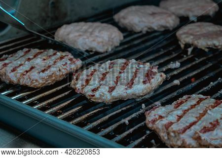 Smoky Hamburger Meat Grilling For Burgers. Bbq Grilled Burgers Patties.