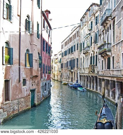 Venice Channel With Surrounding Buildings And A Part Of A Gondola