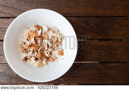 Overhead View Of Crushed Egg Shell In Bowl. Egg Shells Are Organic Fertilizers For Gardening Rich Wi