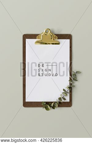 White paper mockup on a clipboard