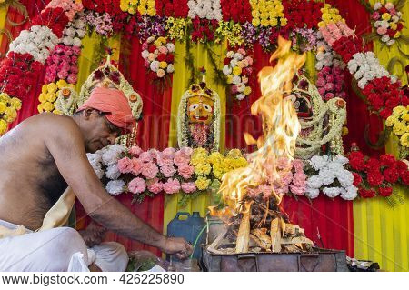 Howrah, West Bengal, India - 29th June 2020 : Hindu Priest Raising Fire Of Yajna To Worship Idol Of