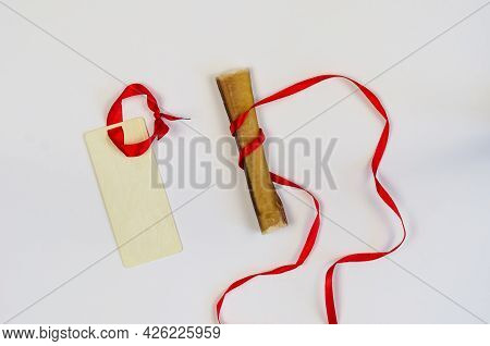 One Dog Treat And Rectangular Sales Tag On White. Air Dried Pet Chew Stick. Bully Stick. Beef Pizzle