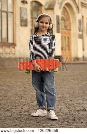 Good For Transportation. Little Child Hold Penny Board Outdoors. Transportation Concept. Summer Tran