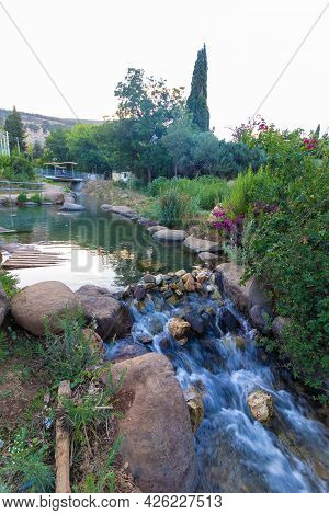 Clear Water Flows In Small Waterfall In The Kurdish Spring In The Middle Of Kiryat Shmona