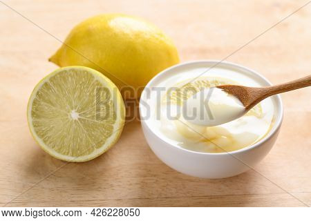 Yogurt In A Bowl With Lemon, Honey And Eating By Spoon, Healthy Food And Beauty Skin Care