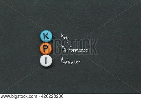 Small Round Cubes With Kpi Letters. Business Concept