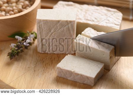 Fresh Tofu Cutting By Kitchen Knife On Wooden Board, Food Ingredient In Asian Cuisine