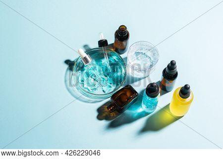 Cosmetics Liquid Gel Serum Hyaluronic Acid With Oxygen Bubbles Various Vials Laboratory Glassware On