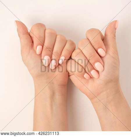 Close-up Women's Hands With A Beautiful Manicure On White Background. Top View Of Crop Woman Show, D