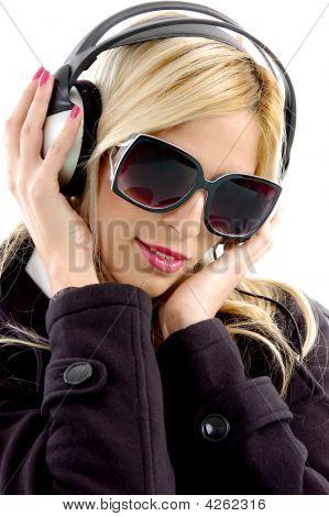 Close View Of Woman Enjoying Music