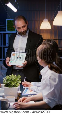 Overworked Businessman Showing Financial Graphs Presentation Using Tablet Brainstorming Company Idea