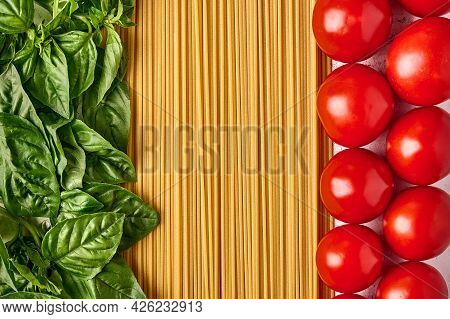 Spaghetti Italian Pasta With Basil Leaves And Tomatoes, Arranged In The Colors Of The Italian Flag.