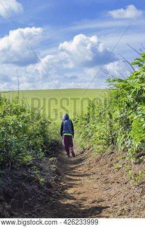 Boy On A Dirt Road To The Hills, Picture Of A Dirt Road To The Hills With Background Clouds