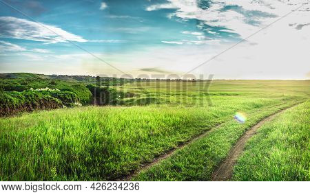 Dirt Road To The Hills, Image Of A Dirt Road To The Hills With Clouds In The Background