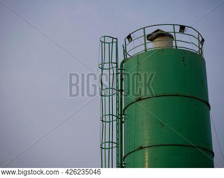 Concrete Mixer Container Machine Presenting Around Sky Industrial Background.