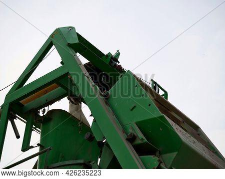 Concrete Mixer Conveyer Belt Machine Presenting Around Sky Industrial Background.