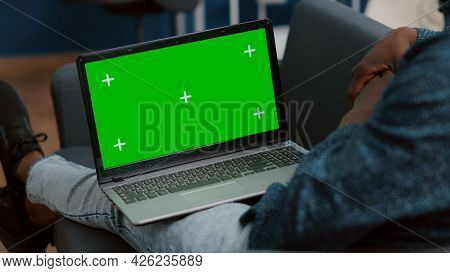 Close Up Of Mock Up Green Screen Laptop Display In African American Guy Laps, Sitting In Bed In Livi