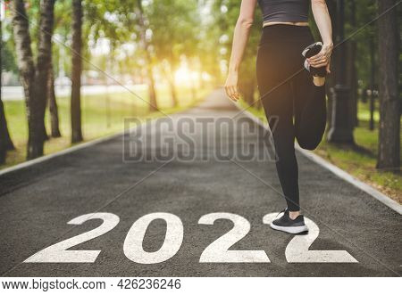 Female Feet In Sneakers At The Start. Beginning And Start Of The New Year 2022, Goals And Plans For