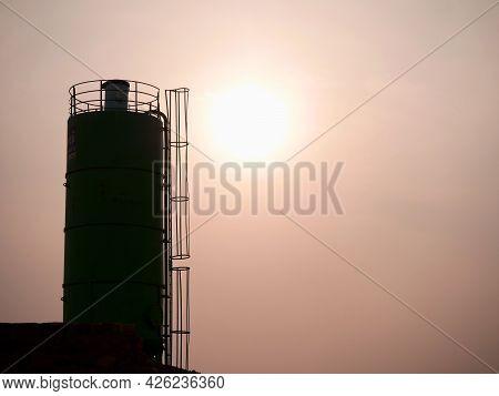 Concrete Mixer Machine Presenting Around Sky Sunset Industrial Background.