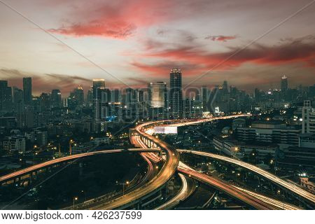 Aerial View Of The Modern Buildings Finance And Highway At Night Of Bangkok Cityscape, Thailand. Car