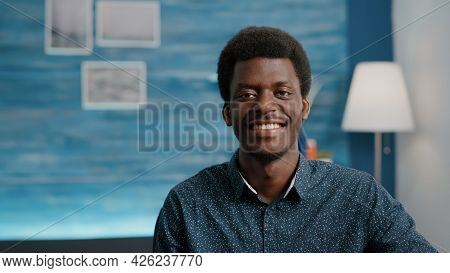 Close Up Portrait Of Charming Handsome African American Man Smiling To Camera, Young Black Man In Co