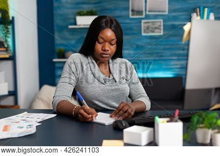 African American Student Writing High School Homework On Notebook During Online Communication Course