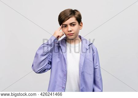 Serious Boy 12-14 Years Old Over Isolated Light Gray Background Thinking An Idea, Dressing In Stylis