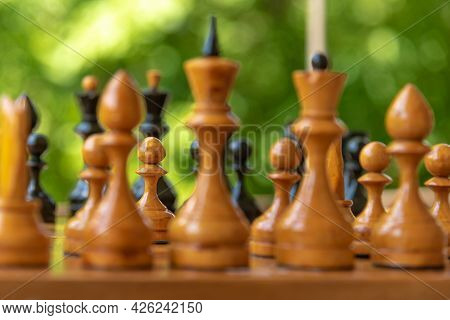 Chess Pieces Of Shabby Old Chess Pieces On A Chessboard Close Up - White Pawn In Selective Focus