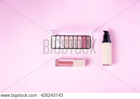 Liquid Concealer Cream With Eyeshadow Palette On Pink Background Top View Flat Lay