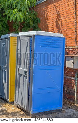 Mobile Toilet Cabins Behind Building Temporary Wc