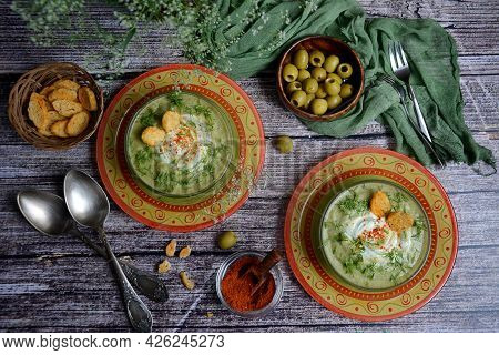 Healthy Soup Of Broccoli, Green Peas And Herbs With Croutons In Colored Bowls, Ready To Eat Next To
