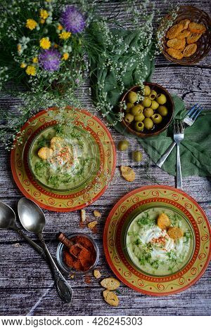 Vertical Cosposition. Vegetarian Soup Of Broccoli, Green Peas And Herbs With Croutons In Colored Bow