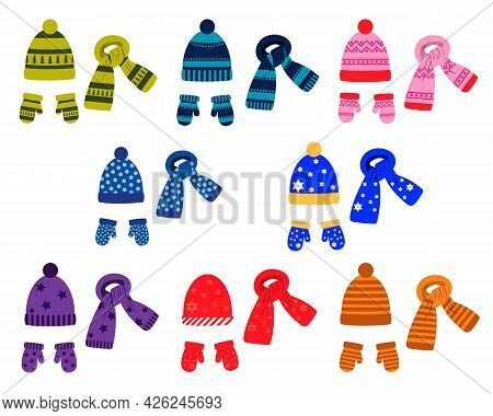 A Set Of Winter Colored Hats, Scarves And Mittens With A Pattern. Vector Isolated On A White Backgro