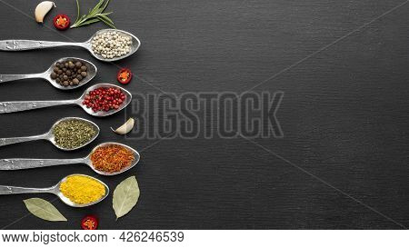 Spoons With Powder Condiments Copy Space. High Quality Beautiful Photo Concept