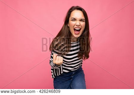Portrait Of Young Positive Happy Beautiful Brunet Female Person With Sincere Emotions Wearing Casual