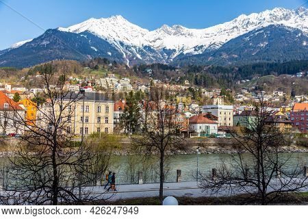 Innsbruck, Austria - 11 April 2015 - Panorama View Of Colorful Buildings And Mountains Across From T
