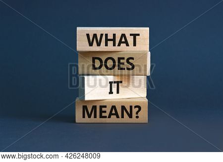 What Does It Mean Symbol. Concept Words 'what Does It Mean' On Wooden Blocks. Beautiful Grey Backgro