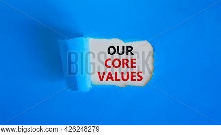 Our Core Values Symbol. Words 'our Core Values' Appearing Behind Torn Blue Paper. Beautiful Blue Bac