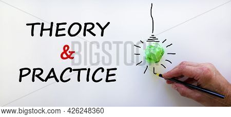 Theory And Practice Symbol. Businessman Writing Words 'theory And Practice', Isolated On Beautiful W