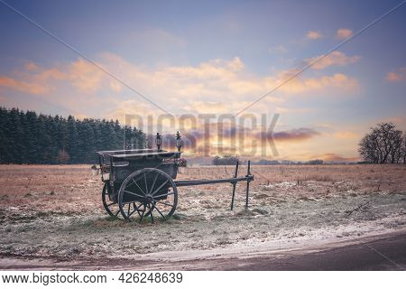 Old Settlers Wagon Standing In The Frost On A Praerie In The Sunset