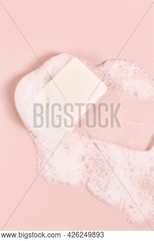 Hand Made Soap In Lush White Foam On A Pink Background. Cosmetic Background Minimalistic Concept. Ve