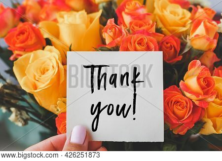 Bright Bouquet Of Orange Yellow Roses And White Cardboard Card With The Inscription Thank You.