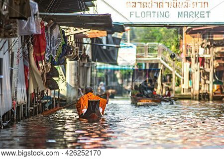 Pottaya, Thailand - 10.11.2019: Monk In Orange Clothes On The Boat At The Amphawa Floating Market