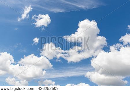 Natural Beautiful Abstract Scenic Azure Blue Sky With White Cumulus Clouds Background On Bright Sunn