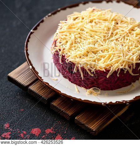 Beet Salad Dish With Cheese On Top. Clay Platter With Grated Beet And Cheese. Close-up Shot. Soft Fo