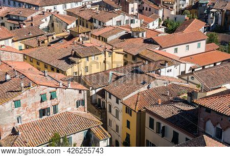 Cityscape With Rooftops From Torre Ginigi Tower. Luca City Tuscany Central Italy
