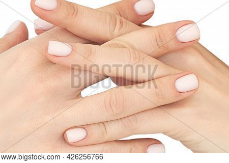 Close Up Clasped Hands Of Woman With Maniqured Nails Isolated On White