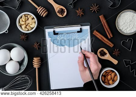 Recipe Baking Cooking Ingredients On Black Background. Top View. Blank Clipboard Copy Space. Home Ba